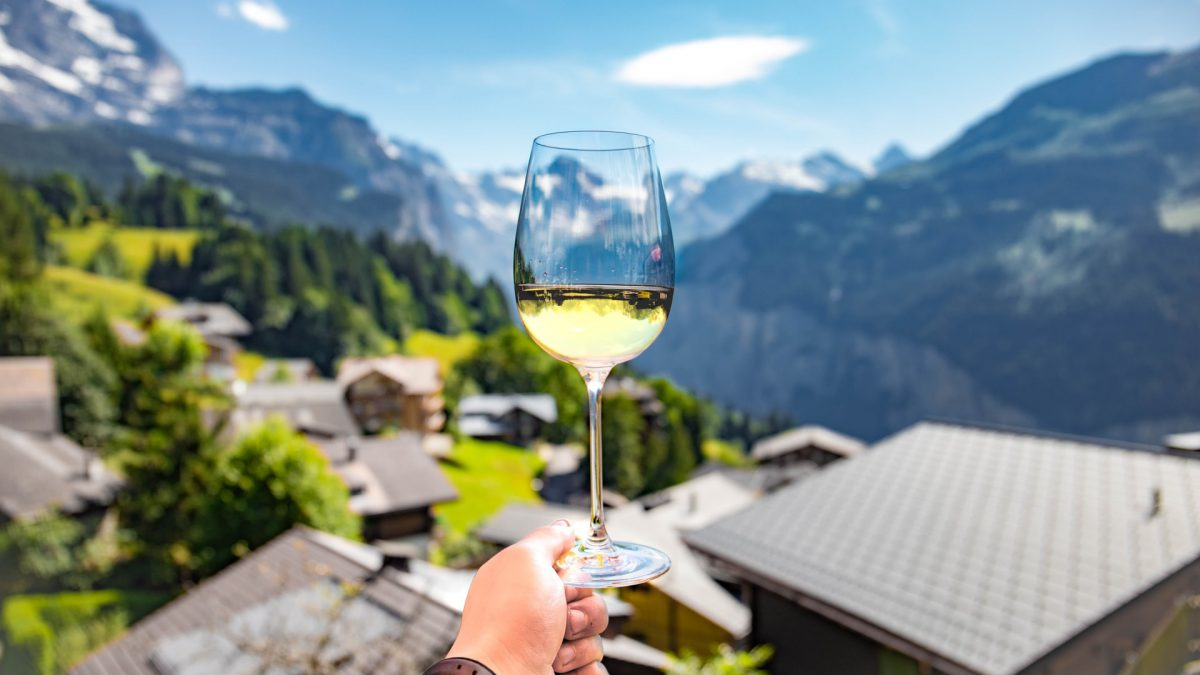 Glass of Wine on a Scenic Village view in Europe