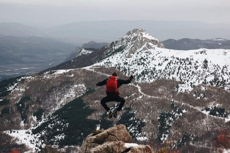 jumping from a mountain outdoor activity