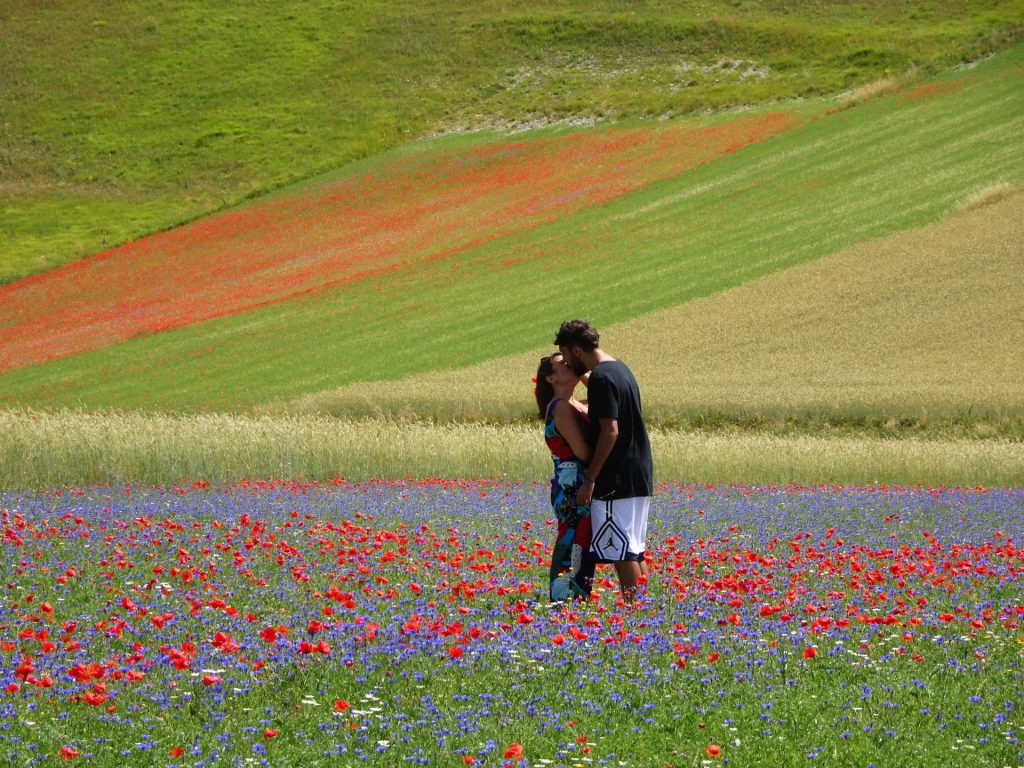 Kissing couple in Norcia, Italy