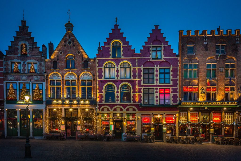 how shops and buildings look at night in Bruges Belgium