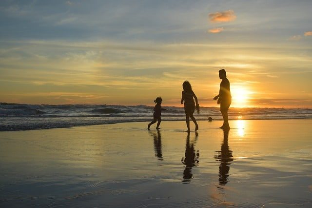 Family during sunset in Ty Nadan, Brittany, France